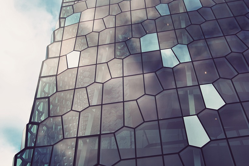 Harpa is located at Reykjavik harbour and its facade was ...