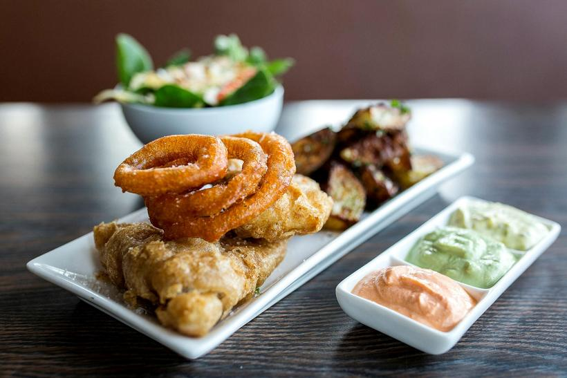 Deep fried Icelandic fish with onion rings, potatoes and skyronnaise ...