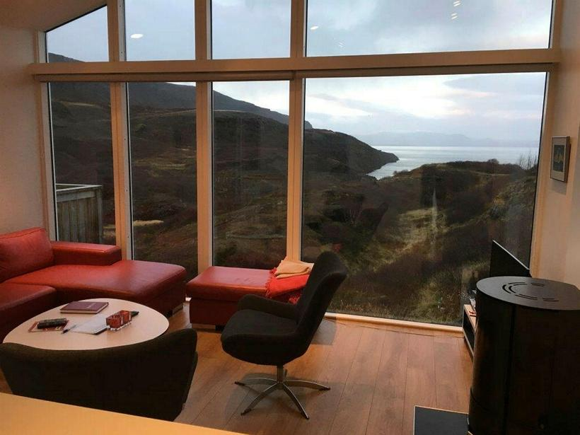 The sitting room offers this gorgeous view of Lake Þingvellir.