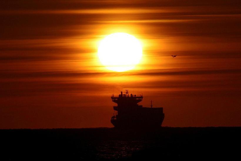 The midnight sun photographed in Eyjafjörður, North Iceland.