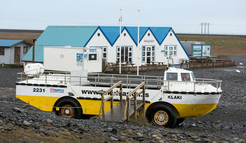 An amphibious vehicle at the glacial lagoon such as the ...