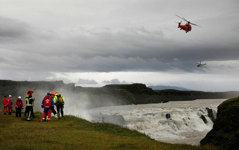 Two Icelandic Coast Guard helicopters over Gullfoss waterfalls during the ...