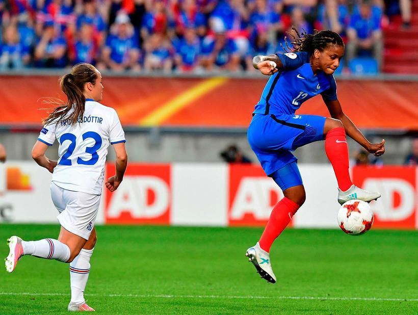 Fanndís Friðriksdóttir up against Elodie Thomis during the match against ...