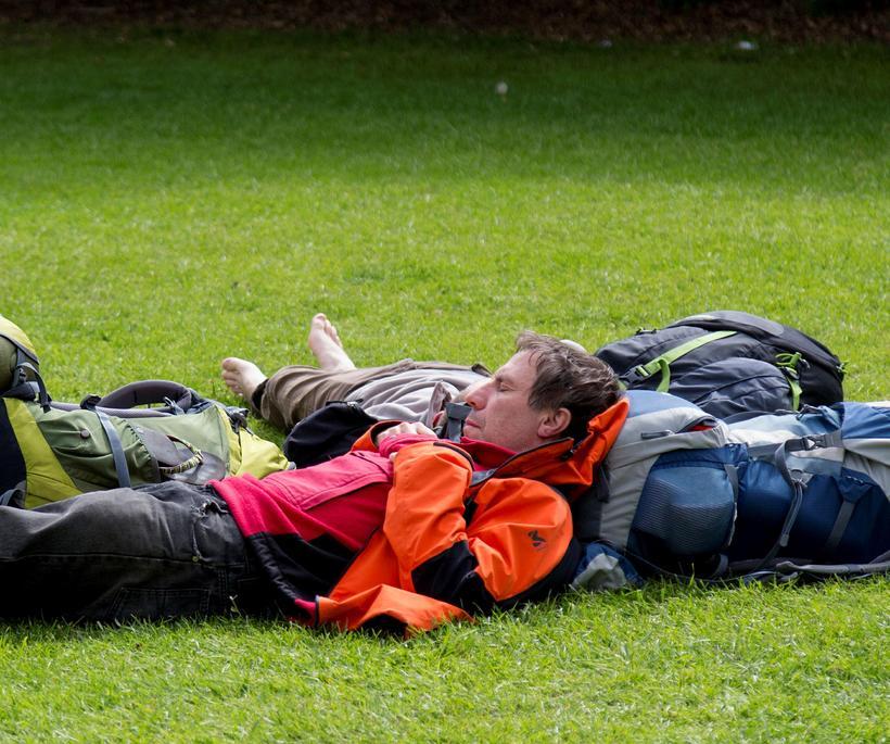 Tourists enjoying the weather in Hljómskálagarður park in the city ...