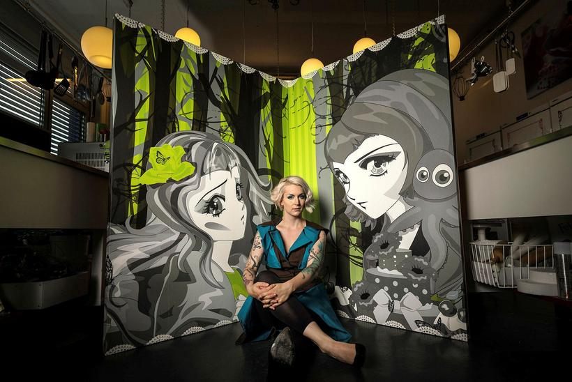 Sara Hochuli sits between paintings of the sisters Miyuko and ...
