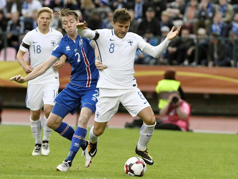 Birkir Már Sævarsson tackles Perparim Hetemaj in Tampere today.