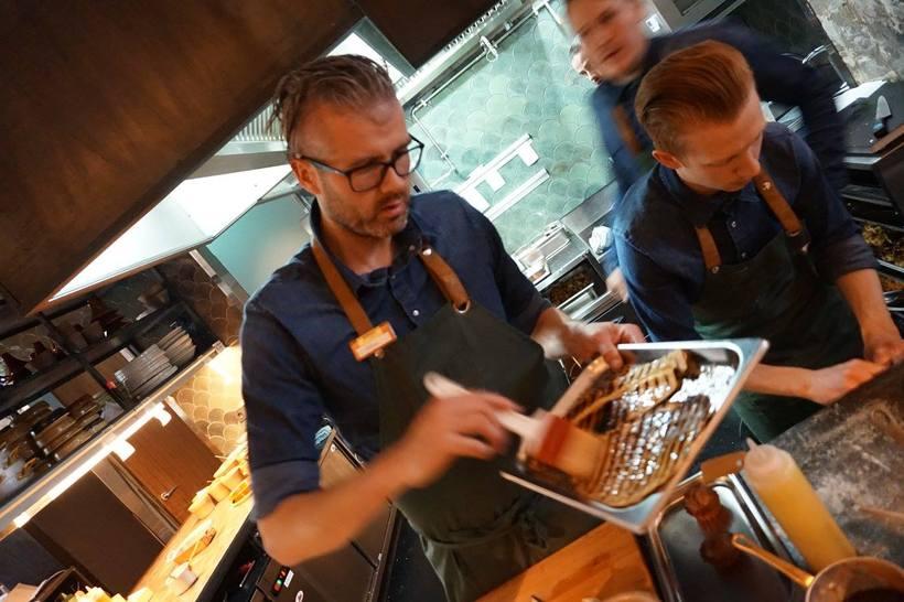 Owner and head chef Þráinn Freyr Vigfússon in the central, ...