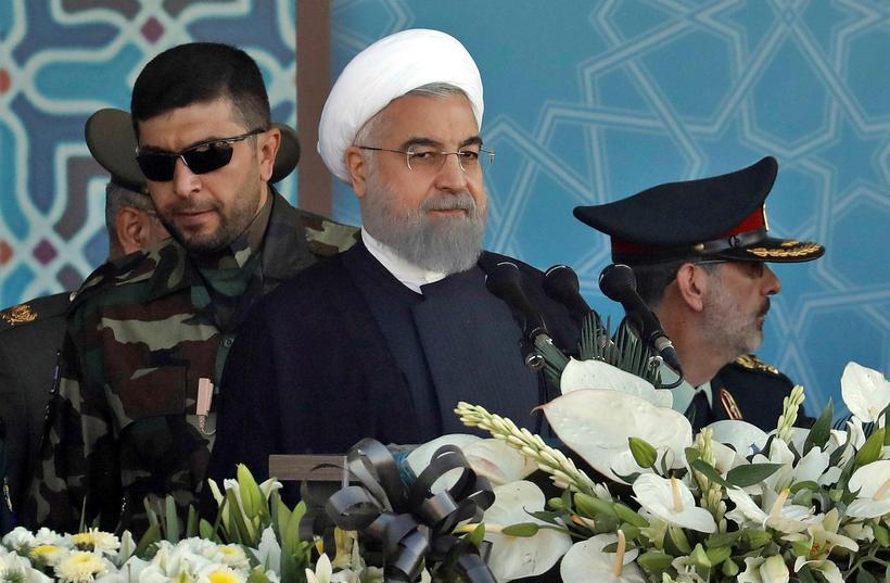 Klerkastjórn er við völd í Íran og er Hassan Rouhani ...