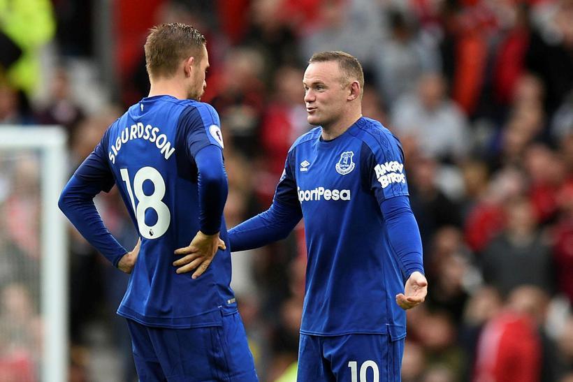 Gylfi Þór Sigurðsson og Wayne Rooney.